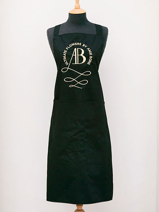 amie bone signature black apron with gold embroidery