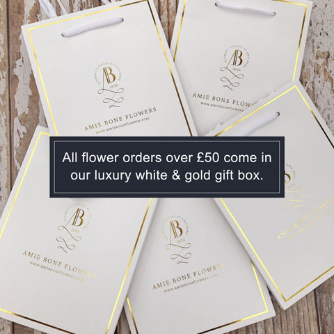 all flower orders over £50 come in our luxury white and gold gift box