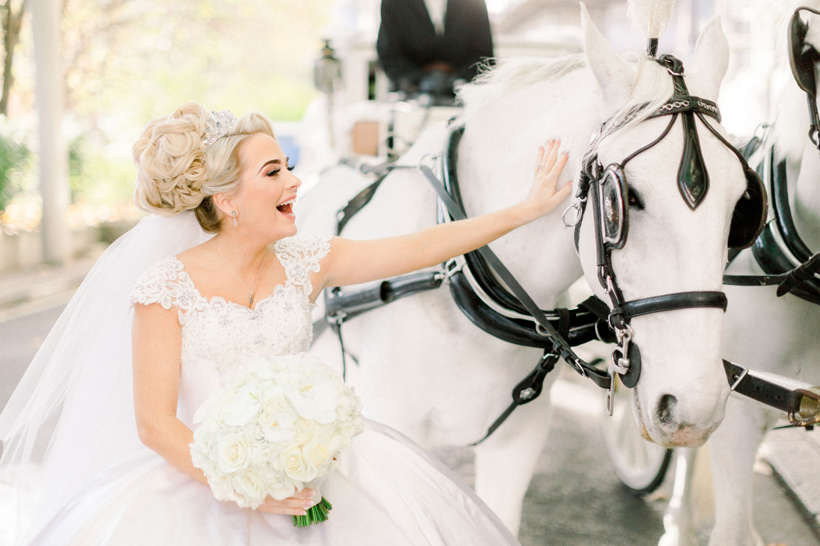 Savoy bride and horse with her bridal bouquet