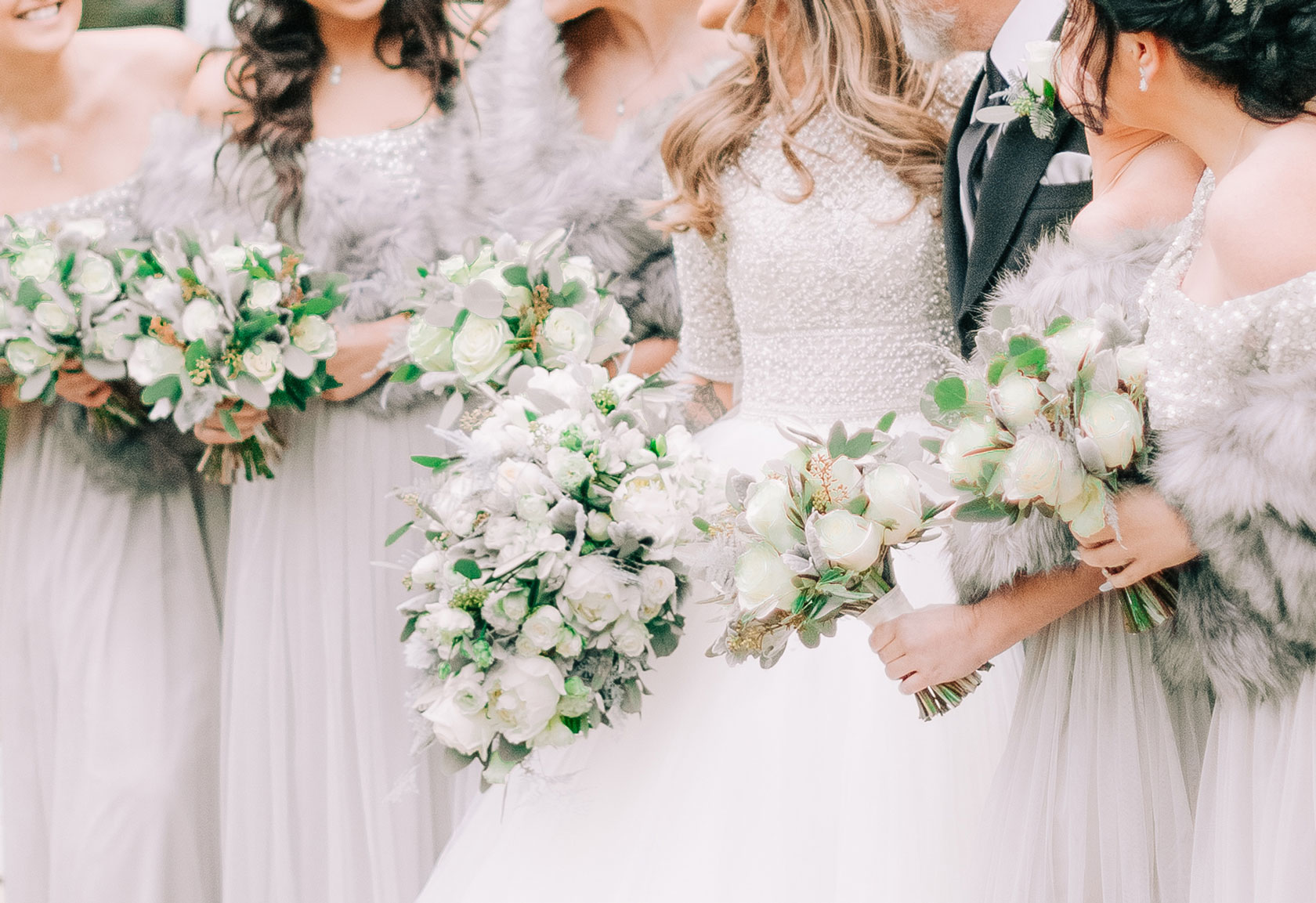 bride and her bridesmaids with their bridal and bridal party bouquets