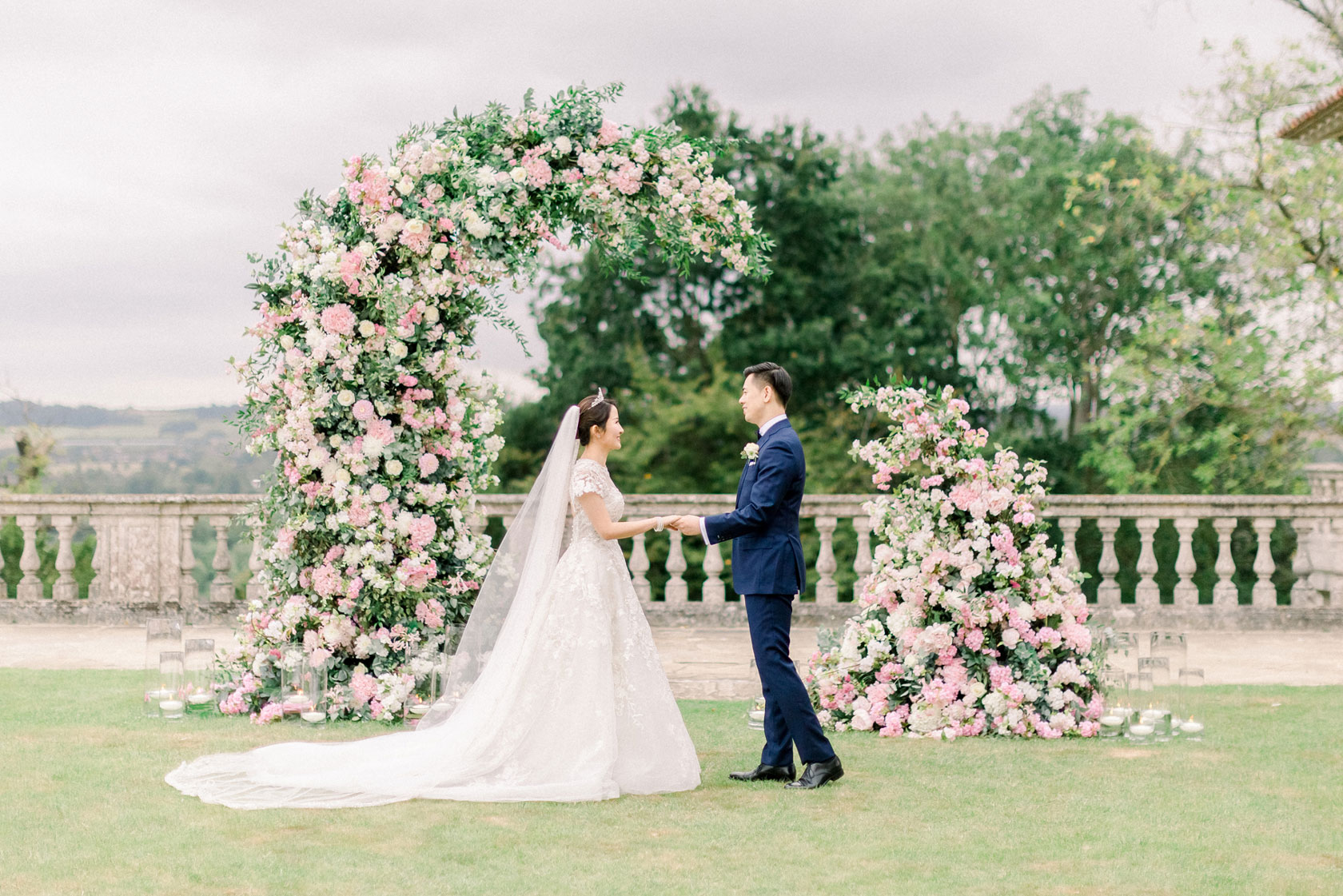 a candlelit wedding in a marquee with hanging florals